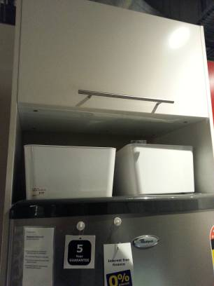 This lift up cabinet has been installed above a fridge: much too high to comfortably pull down that handle.
