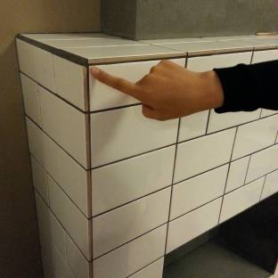 Ensure all tiling is finished properly with appropriate edge finishing.