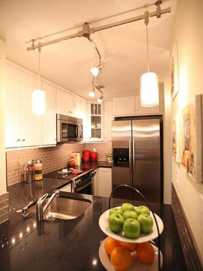 Track-Lighting-Design-For-Small-Kitchen-With-Brick-Backsplash-Also-White-Wooden-Kitchen-Design-Also-White-Painted-Wall-860x1148