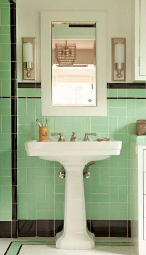 A minty green wall tile creates a charming and energetic vibe in this bathroom. pair with a black border for a striking effect.