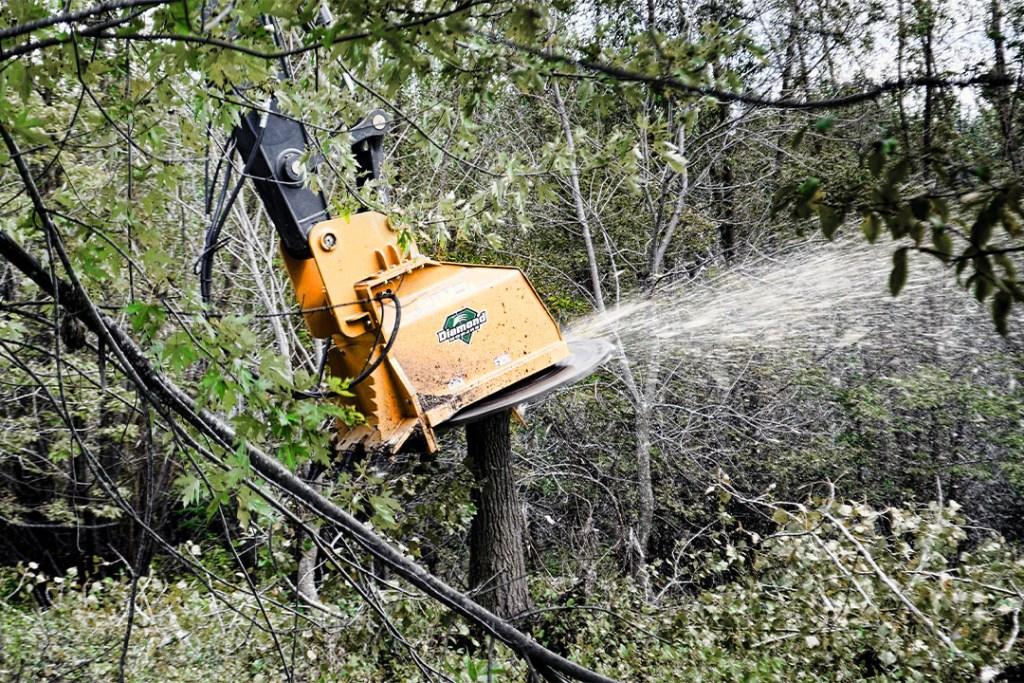 Excavator Forestry Disc Mulcher in action
