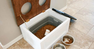 Pet Food Bins and Dog Bowls on the Kitchen Floor   Diamond Pet Foods