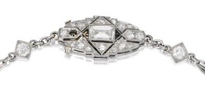 Clasp detail; a platinum, emerald and diamond lavallière, circa 1930. Via Diamonds in the Library.