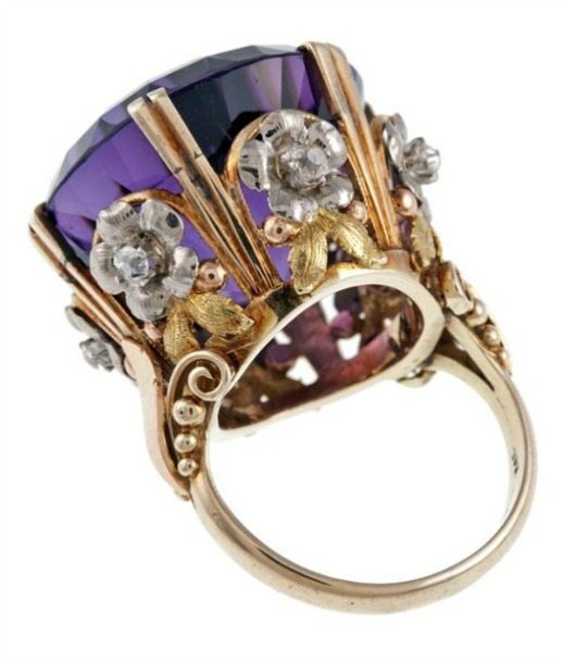 Alternate view; Victorian 'tri-gold' amethyst diamond antique cocktail ring. A huge, deep purple amethyst set in a gold ring of diamond-centered flowers. Circa 1880.