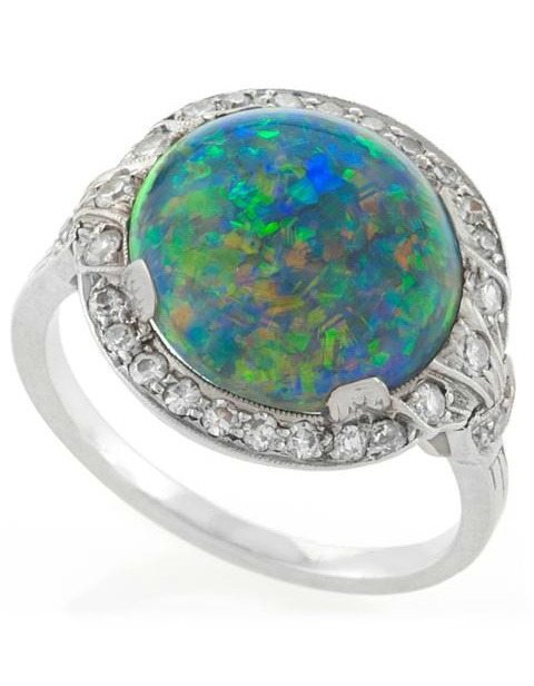 Art Deco black opal and diamond ring by J. E. Caldwell, circa 1925. Via Diamonds in the Library.