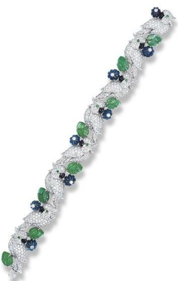 Cartier diamond, emerald, and sapphire bird bracelet.  Via Diamonds in the Library.