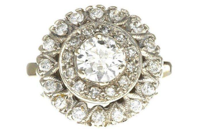 A diamond bombé ring. Via Diamonds in the Library.