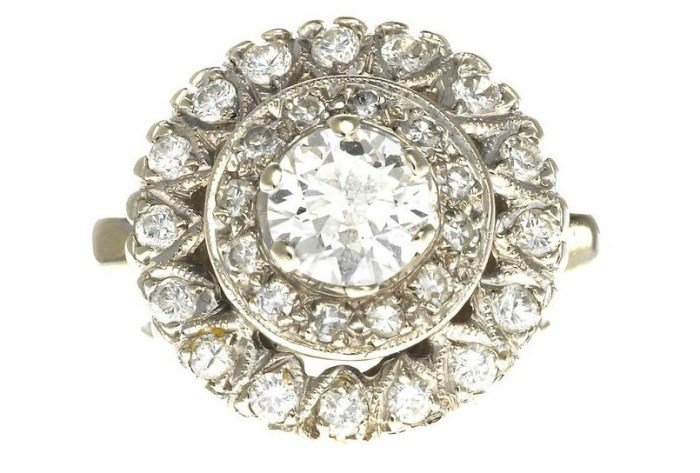 A diamond bombé ring. Via Diamonds in the Library.