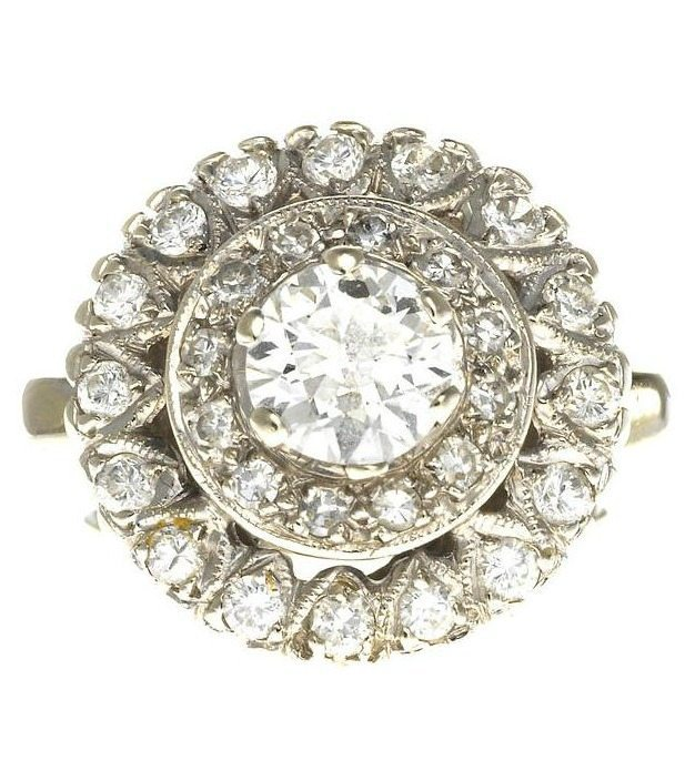 A fabulous diamond bombé ring. Via Diamonds in the Library.