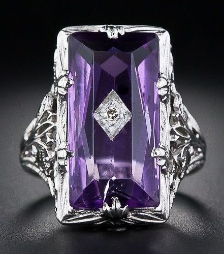 A vintage amethyst and diamond filigree ring.