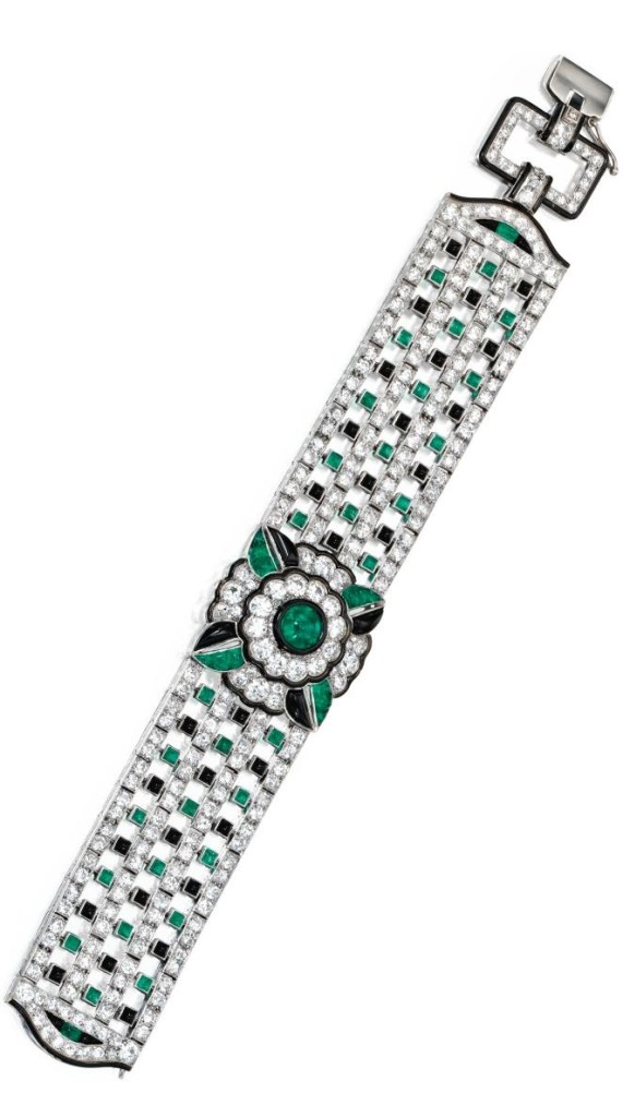 An Art Deco diamond, emerald, onyx, and enamel bracelet by Mauboussin, circa 1925. Via Diamonds in the Library.