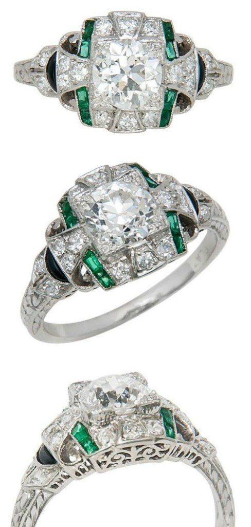 An Art Deco era platinum, diamond, emerald and onyx engagement ring. Circa 1930's. Via Diamonds in the Library.