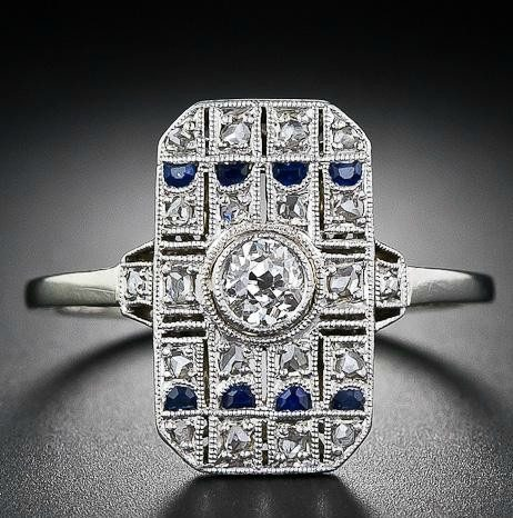 Early Art Deco diamond and sapphire dinner ring. Via Diamonds in the Library.