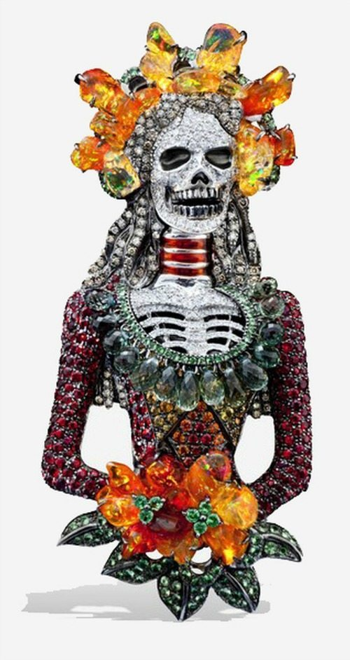 Lydia Courteille's Santa Muerte pendant. With fire opals, sapphires, and diamonds.