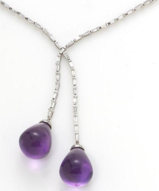A diamond and amethyst lavalier necklace. Via Diamonds in the Library.