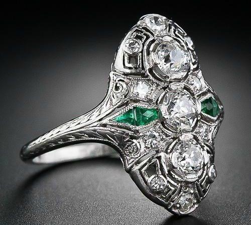 An Art Deco diamond calibre emerald dinner ring, circa 1930's. Via Diamonds in the Library.