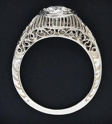 An Art Deco filigree diamond engagement ring with a .56 carat old european cut Circa 1920s. Via Diamonds in the Library.