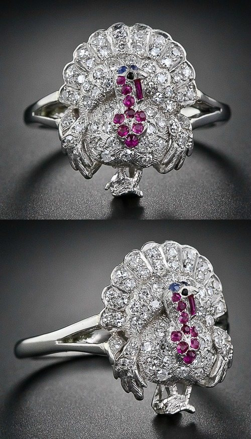An antique Art Deco diamond, ruby, sapphire and onyx turkey ring from 1920-1930. Via Diamonds in the Library.