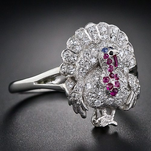 An antique diamond, ruby, sapphire and onyx turkey ring from 1920-1930. Via Diamonds in the Library.