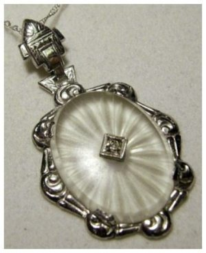 Art Deco camphor glass and diamond pendant on 22 inch chain, circa 1930's.
