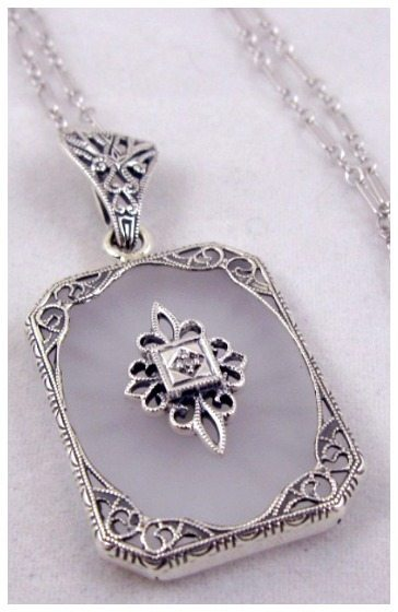 Art Deco sun ray camphor glass pendant necklace with diamond filigree.