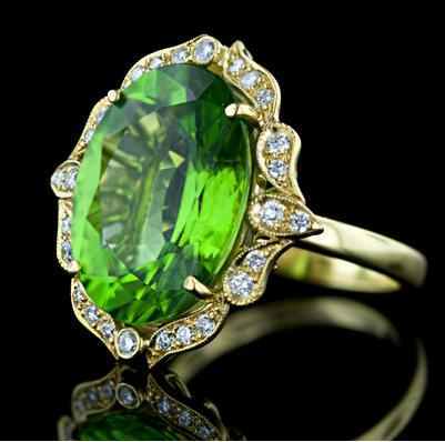 Gorgeous peridot and diamond ring, alternate view. Via Diamonds in the Library.