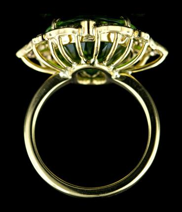 Gorgeous peridot and diamond ring, side view. Via Diamonds in the Library.
