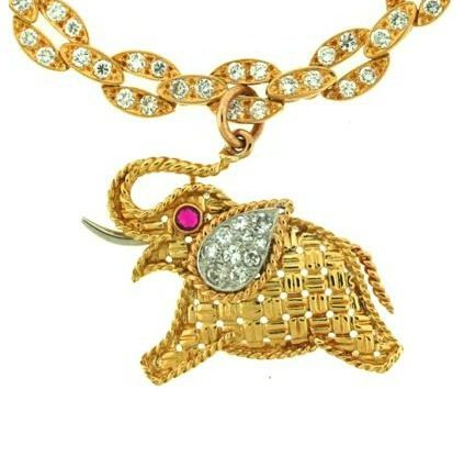Pendant detail - a vintage Van Cleef and Arpels gold and diamond elephant charm bracelet. Via Diamonds in the Library.