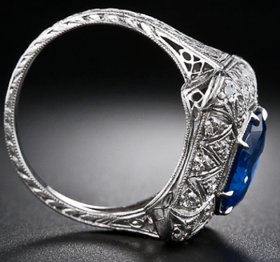 Side view; early Art Deco sapphire and diamond filigree ring. Via Diamonds in the Library.