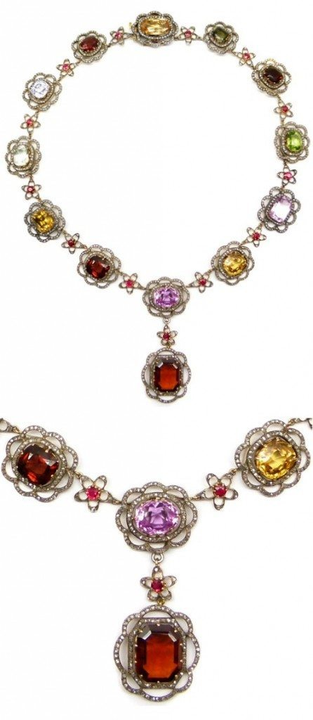 19th century gem and diamond necklace with rubies, garnets, white sapphires, aquamarines, yellow zircons, pink topaz, peridot, tourmaline, and orange topaz.
