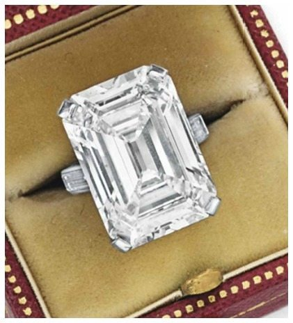 An exceptional engagement ring by Cartier. Center stone is approx 19.86 carats. Via Diamonds in the Library.