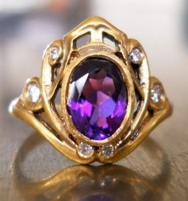 Antique Art Nouveu amethyst and diamond ring in gold.
