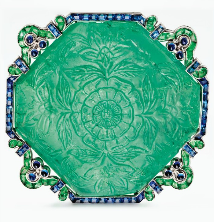 Art Deco carved emerald and sapphire brooch by Cartier, circa 1920. Via Diamonds in the Library.