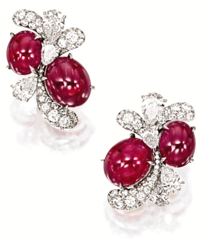 Earrings from the ruby and diamond fireworks set by James W. Curren for Faidee. Via Diamonds in the Library.
