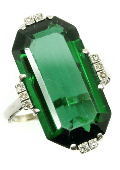 Single stone green tourmaline and diamond dress ring. Via Diamonds in the Library.