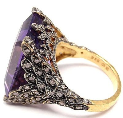 A Cathy Waterman gold, diamond and amethyst winged ring. Via Diamonds in the Library.