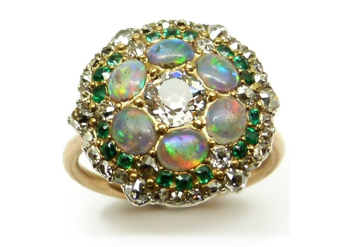 A beautiful antique opal, diamond, and emerald cluster ring, formerly a button. Circa 1820.