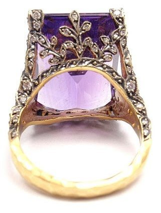 Alternate view; Cathy Waterman gold, diamond and amethyst winged ring. Via Diamonds in the Library.