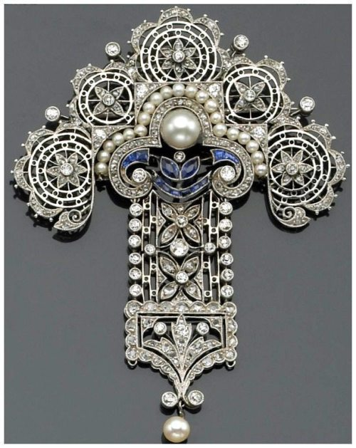An antique Edwardian diamond, cultured pearl, sapphire and platinum brooch.