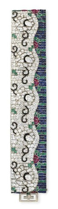 An art Deco diamond and multi-gem wave bracelet by Rubel Freres. Circa 1925. Via Diamonds in the Library.