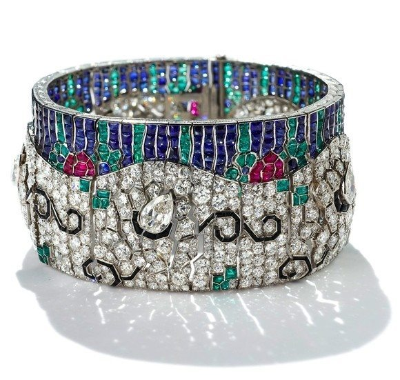 An exceptional Art Deco diamond and multi-gem wave bracelet by Rubel Freres. Circa 1925. Via Diamonds in the Library.