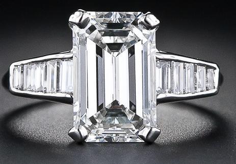1950's 3.18 carat emerald-cut diamond engagement ring with baguette diamond embellishment.
