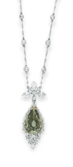 A Belle Epoque colored diamond & diamond necklace, with a pear-shaped fancy dark gray-yellowish green diamond, weighing approximately 5.84 carats. Circa 1910. Via Diamonds in the Library.