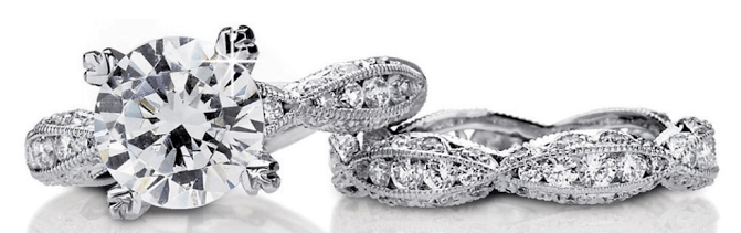 A stunning Tacori wedding set; engagement ring 2578RD9 and wedding band 2578 B. Via Diamonds in the Library.