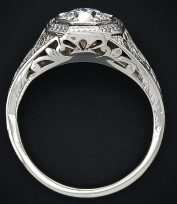 Alternate view of an Edwardian diamond solitaire and filigree engagement ring, late 1920's. Via Diamonds in the Library.