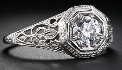 An Edwardian diamond solitaire and filigree engagement ring, late 1920's. Via Diamonds in the Library.