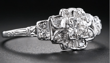 An antique floral Art Deco engagement ring, circa 1930's. Via Diamonds in the Library.