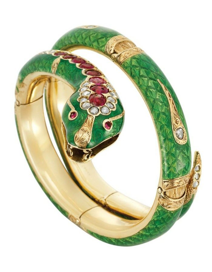 Antique snake bangle with gold, enamel, diamonds, and rubies. Via Diamonds in the Library.