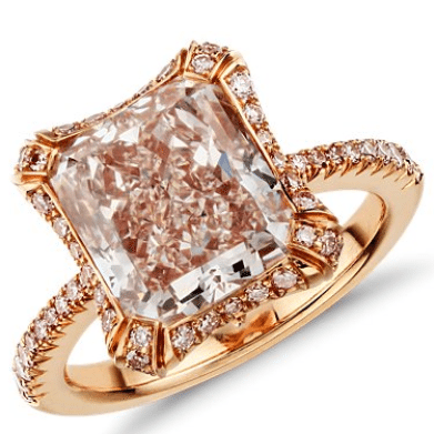 Blue Nile Heirloom collection's one of a kind Fancy Pink radiant cut micropavé halo diamond ring. Via Diamonds in the Library.