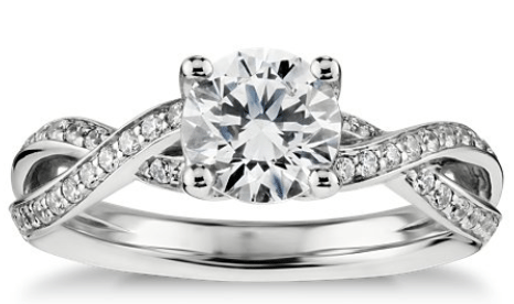 Blue Nile's Twist pavé diamond engagement ring in 14k white gold. Via Diamonds in the Library.
